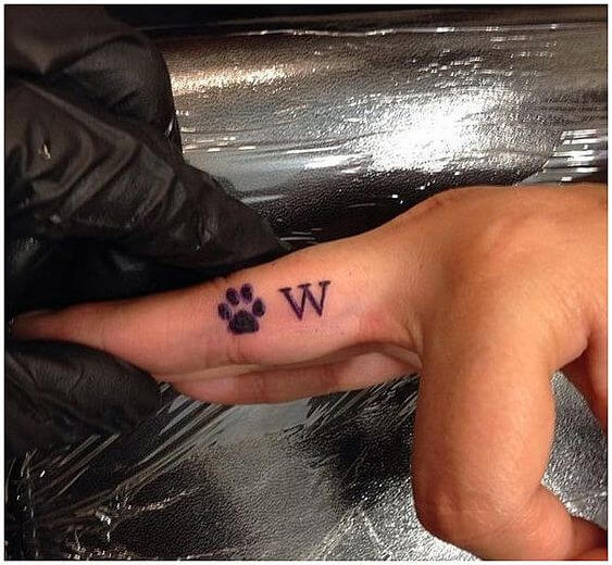 Dog Paw finger tattoo