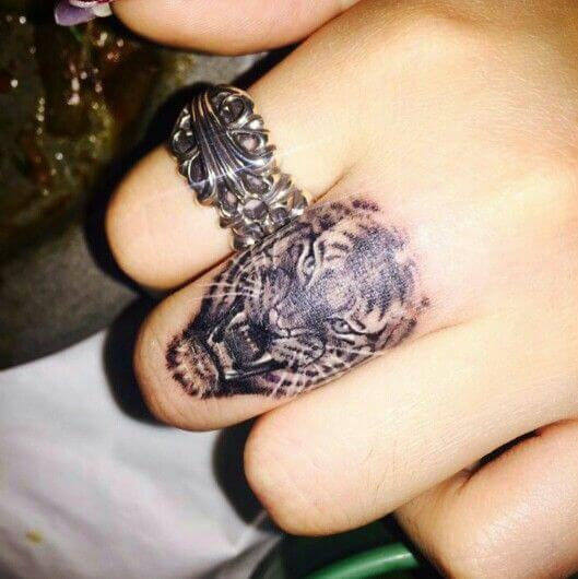 Fierce Tigress finger tattoo