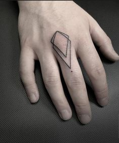 Geometric finger tattoo