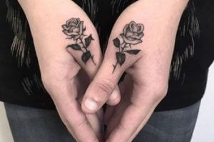 black rose finger tattoo
