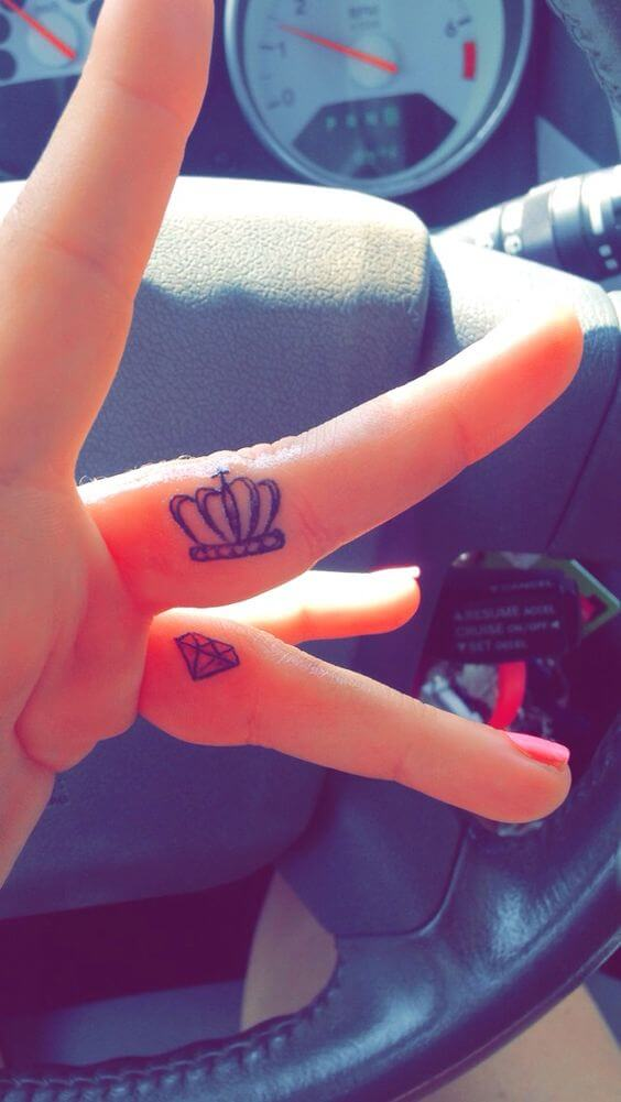 crown and diamond finger tattoo