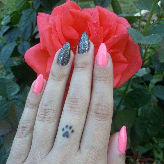 cute Dog Paw finger tattoo