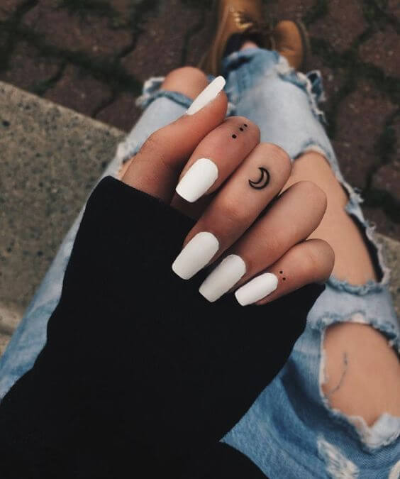 moon finger tattoo
