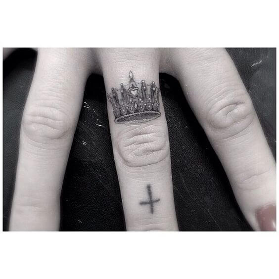 small Crown finger tattoo