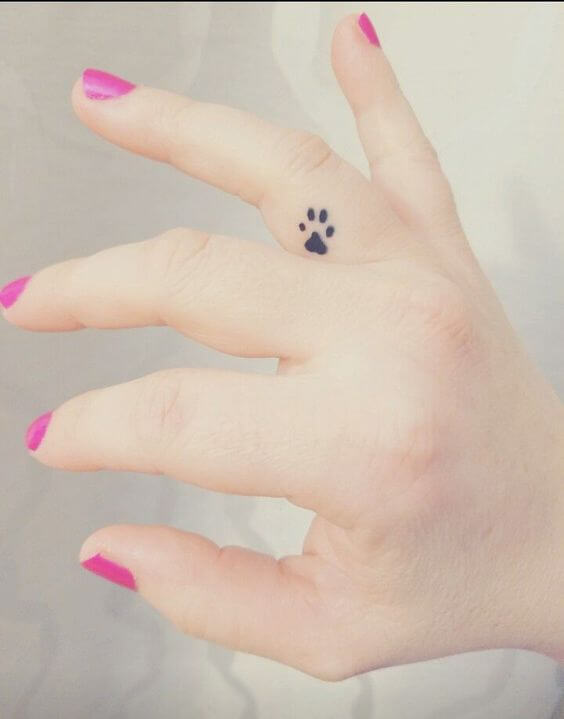 small Dog Paw finger tattoo