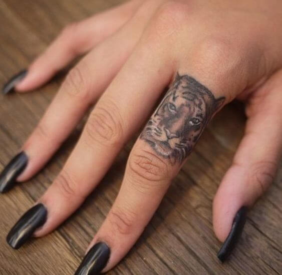 tiger finger tattoo for women