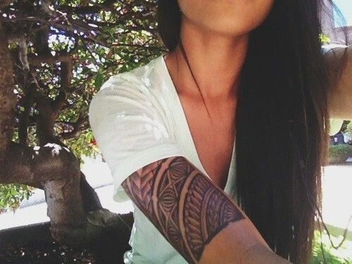 Tribal half-sleeve tattoo for women