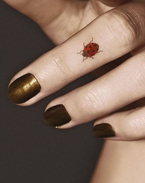 ladybugs tattoo on finger