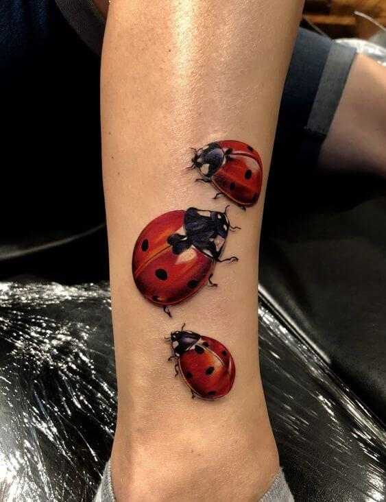 realistic ladybugs tattoo