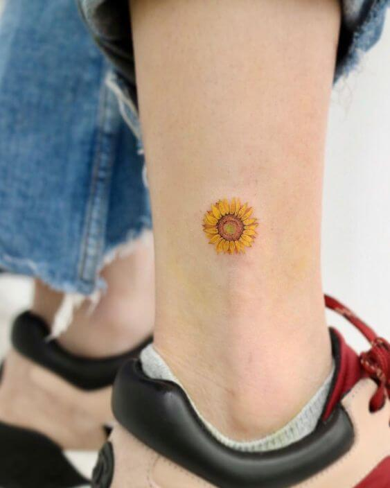 small coloured sunflower tattoo
