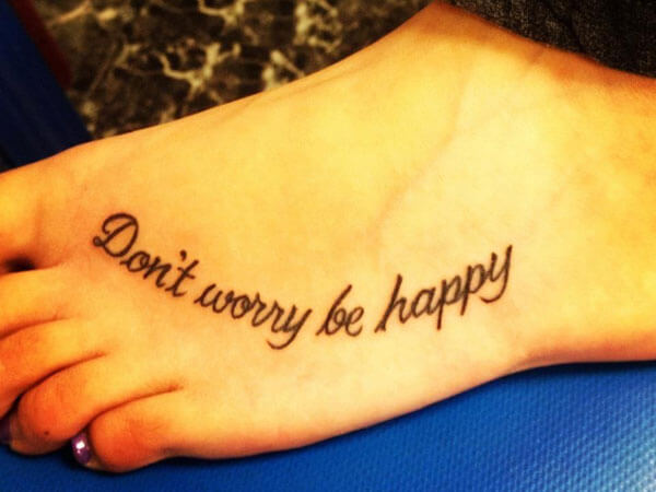 Don't worry be happy foot tattoo