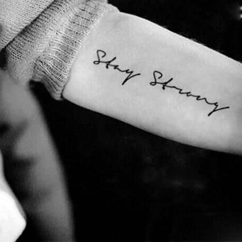Stay strong tattoo on wrist