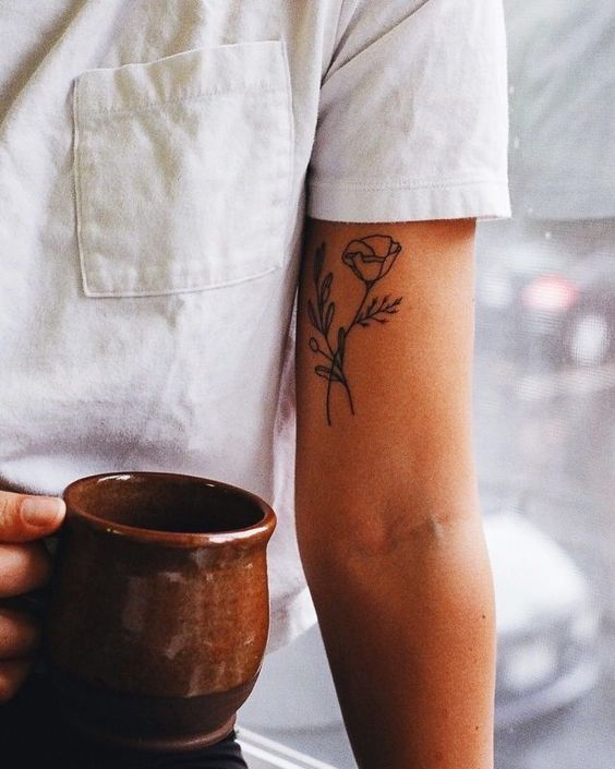 small floral bicep tattoo