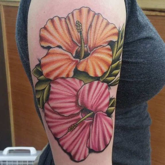 Black hibiscus tattoos with foliage