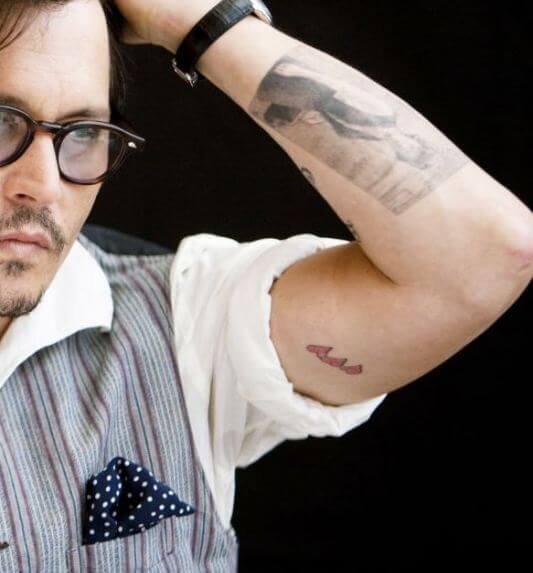 johnny depp Three Hearts tattoo