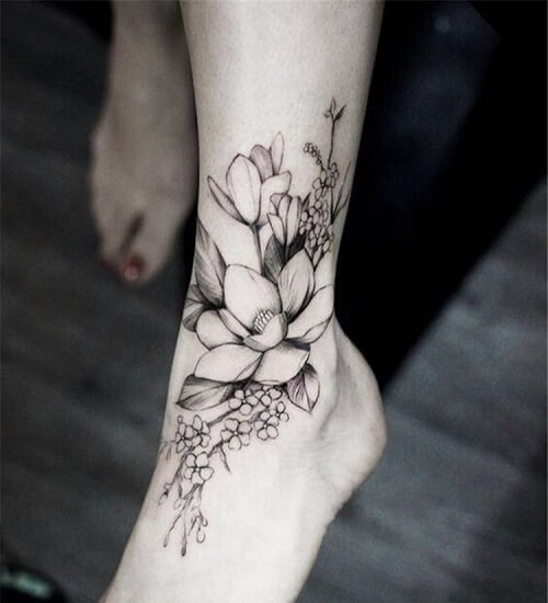 Ankle Flower Tattoo Extending Down the Foot